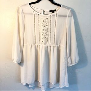 Monteau Ivory Embroidery Detail Peplum Top